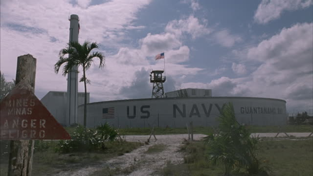 tracking-in to guantanamo naval base, cuba. - guantanamo bay stock videos & royalty-free footage