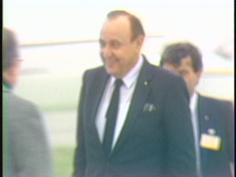stockvideo's en b-roll-footage met ms trackingleft as he walks germany foreign minister hansdietrich genscher arrives in brussels germany for the upcoming european economic community... - business or economy or employment and labor or financial market or finance or agriculture