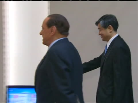 trackingleft italy prime minister silvio berlusconi arriving at g20 summit in seoul and shakes hands with greeter berlusconi acknowledges the camera - business or economy or employment and labor or financial market or finance or agriculture video stock e b–roll