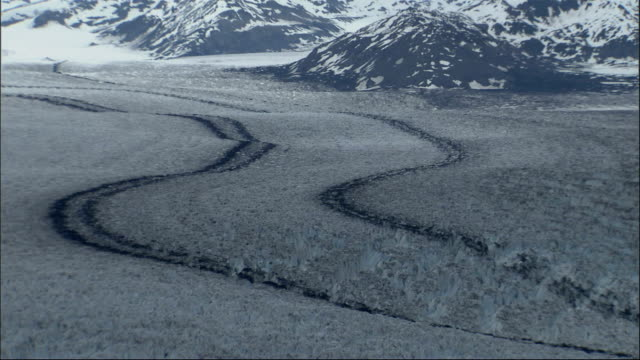 tracks cut across the columbia glacier in alaska. available in hd. - columbia glacier stock videos & royalty-free footage