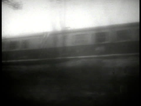 vídeos y material grabado en eventos de stock de railroad tracks passing engine smoke flowing by train passing in countryside countryside passing by railroad employee shoveling coal into engine... - 1933