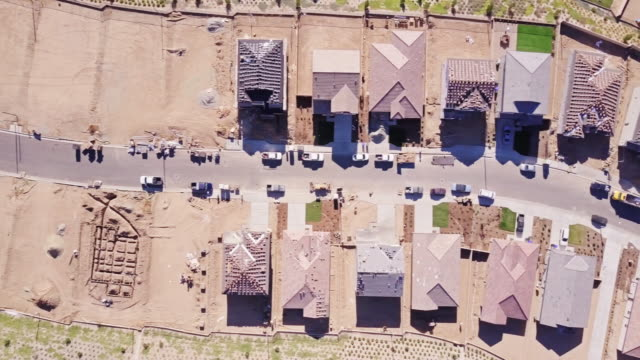 tract homes being built - aerial view - home ownership stock videos & royalty-free footage