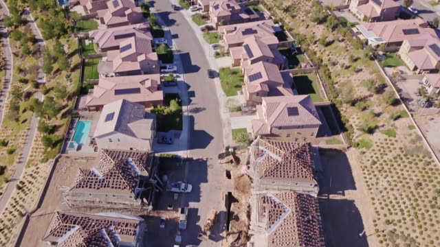 tract house construction - aerial view - tract housing stock videos & royalty-free footage