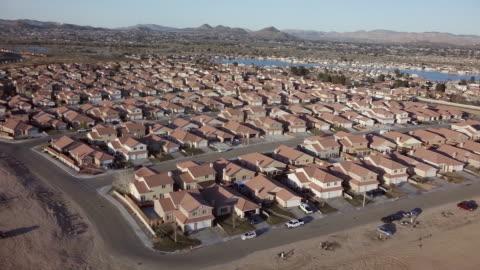 aerial tract housing community in desert - urban sprawl stock videos & royalty-free footage