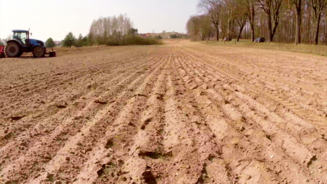 tractor and field dolly shot - plowed field stock videos & royalty-free footage
