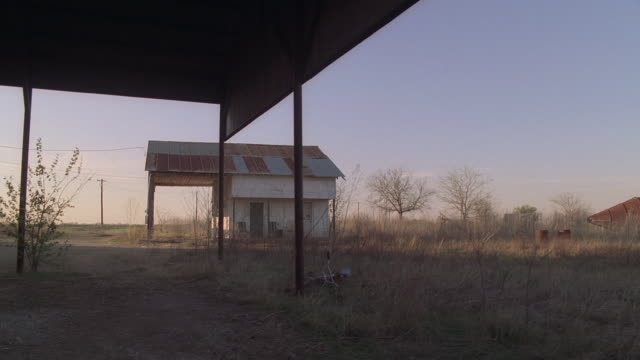 cs tractor and rusty buildings in rural area / kaufman, texas, united states - shed stock videos & royalty-free footage