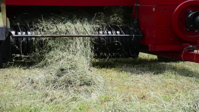 cu tractor baler on farm - 干し草点の映像素材/bロール