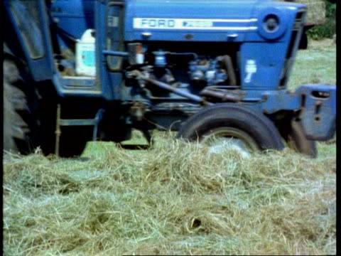 tractor baling hay, england, uk - hay baler stock videos & royalty-free footage