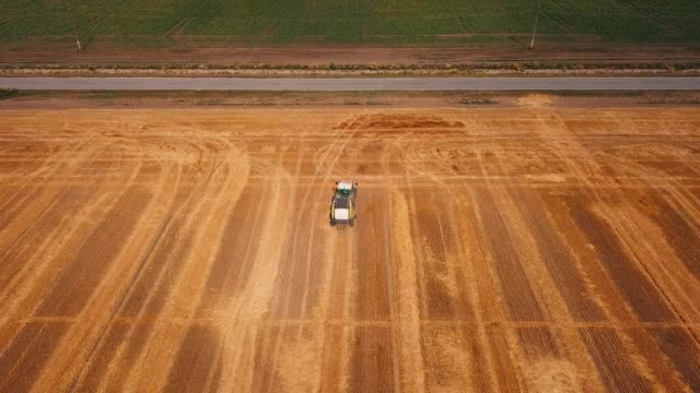 tractor baling straw - hay baler stock videos & royalty-free footage
