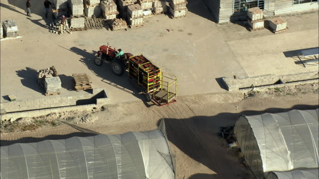 aerial ts tractor delivering crates of strawberries to processing plant, stellenbosch, western cape, south africa - stellenbosch stock videos and b-roll footage