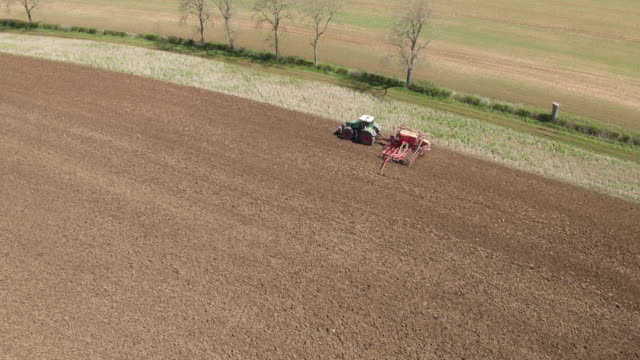 tractor drilling field - plowed field stock videos & royalty-free footage