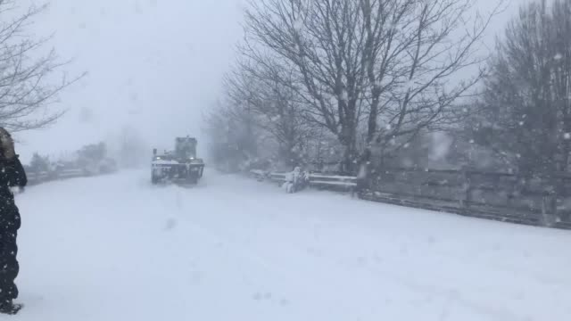 a tractor drives through a blizzard near larbert in scotland and snowy scenes on the m876 motorway as storm emma sweeps across the uk - blizzard stock videos & royalty-free footage