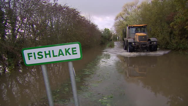 tractor driving through floodwater in the village of fishlake doncaster - weather stock videos & royalty-free footage