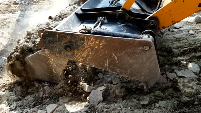 tractor excavator raking stones and land - diesel fuel stock videos and b-roll footage