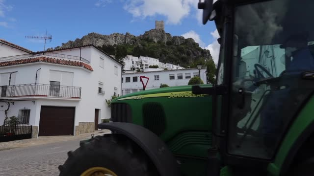 tractor going to disinfect the town. volunteers disinfect the streets of the city during the coronavirus pandemic on april 20, 2020 in zahara de la... - town stock videos & royalty-free footage