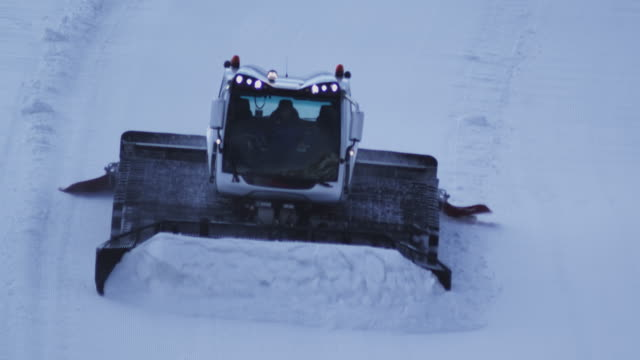 Tractor grooming snow