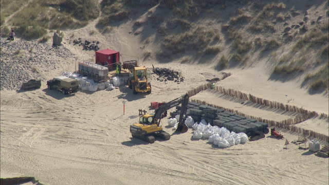 ws aerial tractor jcb working at seashore / sylt, schleswig-holstein, germany - sylt stock videos & royalty-free footage