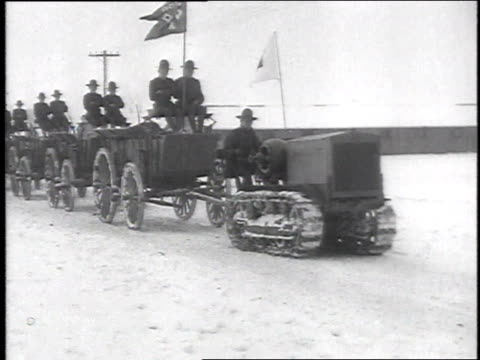 stockvideo's en b-roll-footage met ws tractor on continuous track pulls soldiers on wagons through the snow / camp sherman chillicothe ohio united states - chillicothe