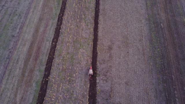 Tractor plowing a field 4k