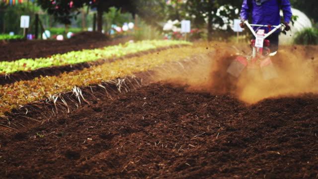 tractor plowing a field - harrow stock videos & royalty-free footage