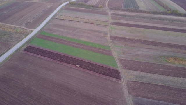 Tractor plowing a meadow 4k