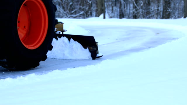 tractor plowing snow - snowplough stock videos & royalty-free footage