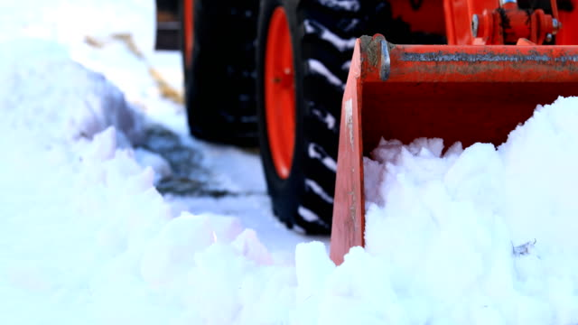 tractor plowing snow - vehicle scoop stock videos and b-roll footage