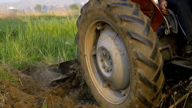 tractor preparing land with seedbed cultivator - tractor stock videos and b-roll footage