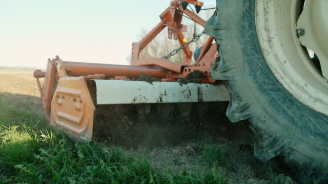 slo mo tractor pulling the harrow - harrow stock videos & royalty-free footage