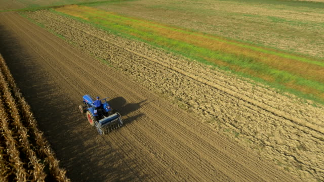 AERIAL Tractor Seeding The Field