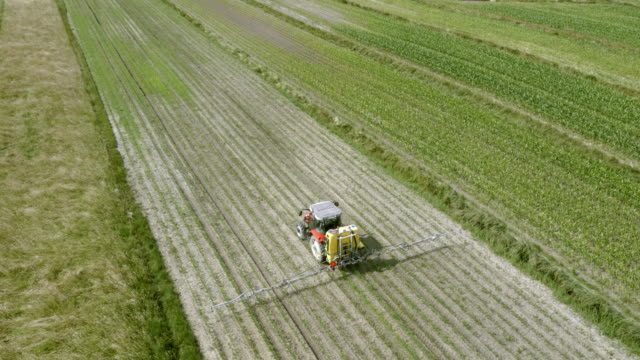 AERIAL Tractor spraying the crops