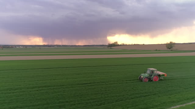 aerial tractor spreading fertilizer over a field - fertilizer stock videos & royalty-free footage