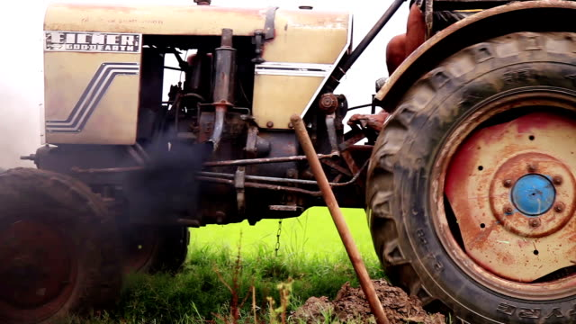 tractor stuck in mud - mud stock videos & royalty-free footage