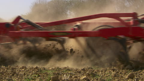 tractor tows plough in field, uk - tractor stock videos & royalty-free footage