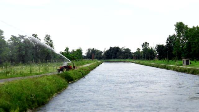 tractor watering plants