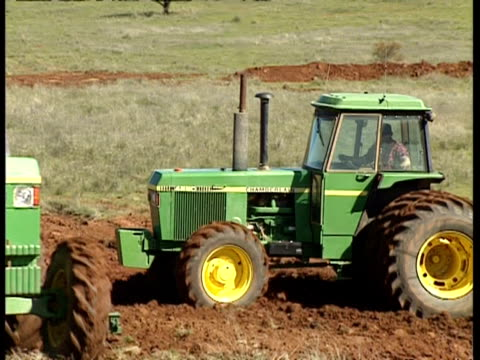 ms 2 tractors, 1st pulling harrow followed by plough - harrow agricultural equipment stock videos & royalty-free footage