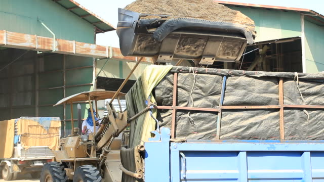 Tractors are loaders husks into the truck