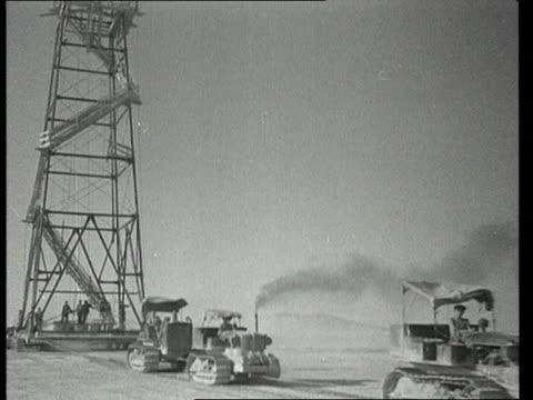 stockvideo's en b-roll-footage met tractors pulling a drilling derrick in turkmenistan desert/ audio - ver
