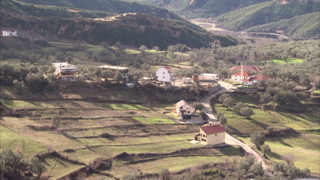 tracts of farmland characterize a rural area. available in hd. - tirana stock videos and b-roll footage