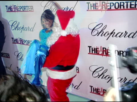 Tracy Bingham gets high on Santa at the Jason Davis Chopard and The Hollywood Reporter Party to Benefit The Nancy Davis Foundation at Chopard in...