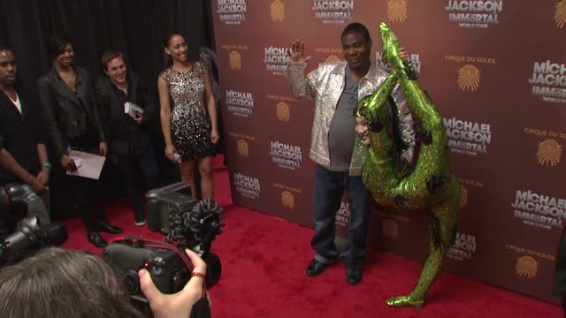 Tracy Morgan and Cirque du Soleil performer at Michael Jackson The Immortal World Tour New York Premiere at Madison Square Garden on April 03 2012 in...