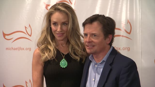 tracy pollan and michael j fox at a funny thing happened on the way to cure parkinsons at the waldorf astoria hotel on november 10 2012 in new york... - michael j. fox stock videos and b-roll footage