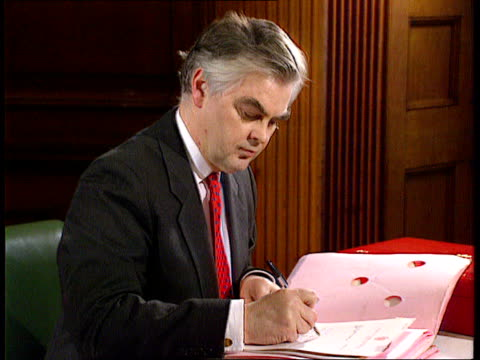 trade deficit; london cms side norman lamont seated at desk writing itn tx 13.2.91 - recession stock videos & royalty-free footage