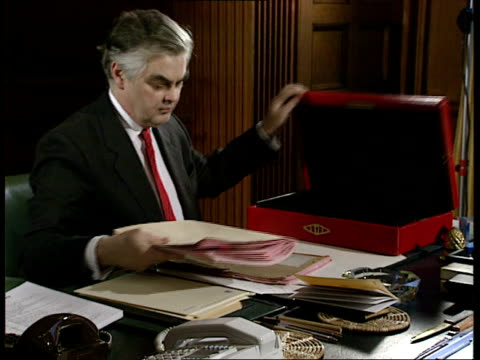 cms chancellor norman lamont sitting at desk working on papers from red despatch box zoom in - recession stock videos & royalty-free footage