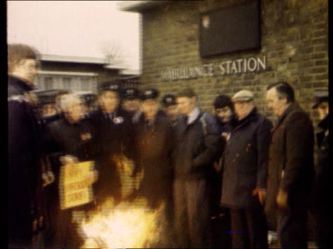 trade union power; unknown location: seq ambulance workers on picket line pull out rubbish in streets rr7905/2.2.79/itn - trade union stock videos & royalty-free footage