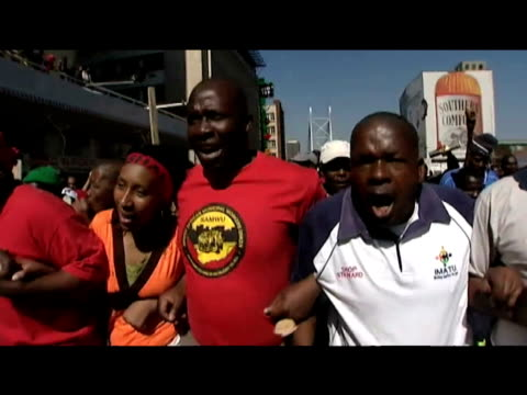 trade unionists and council workers walk arm in arm along nelson mandela bridge in protest over poor wages johannesburg 27 july 2009 - employment issues stock videos & royalty-free footage