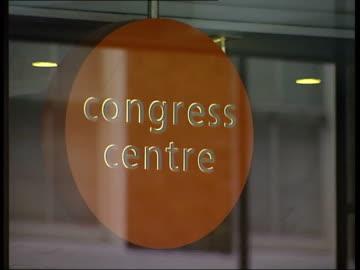 trade unions working on new agenda to create a mega-union; ext gv trade union congress building cms orange circular sign 'congress centre' tuc' logo... - 労働組合会議点の映像素材/bロール