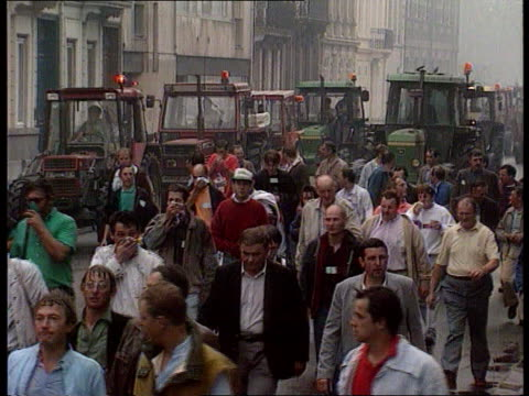 delors visit itn lib france lille tms farmers marching along towards with tractors in b/g - lille stock videos & royalty-free footage