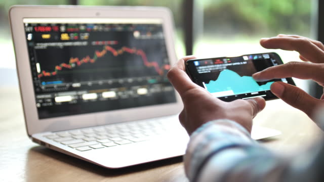 trader analysis on information, investment on smart phone - bull market stock videos & royalty-free footage