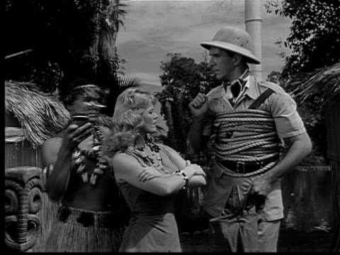 ms, cu, b&w, trader corn commercial, 1950's  - 草葺小屋点の映像素材/bロール